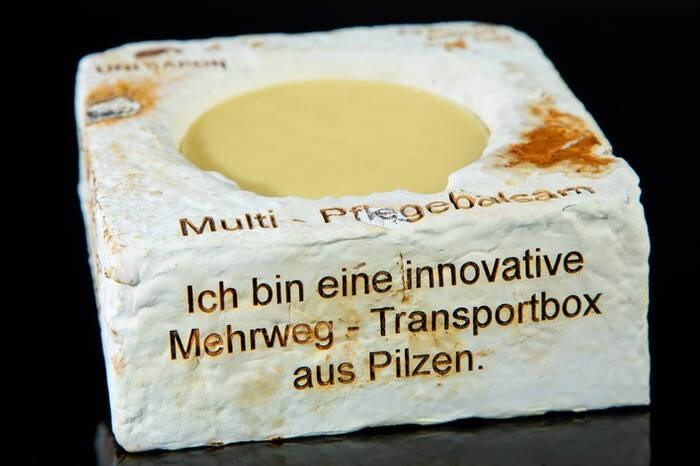 "LOGO_Multi - Pflegebalsam ""unverpackt"" - in der innovativen Mehrweg-Transportbox aus Pilzmycel"