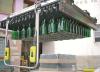LOGO_Semi-automatic depalletizer for new bottles.