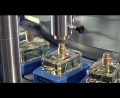 LOGO_FILLING AND CAPPING MACHINE SYNCHRO FOR PERFUMES