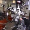LOGO_Roboterzelle zum Entgraten und Fräsen von Aluminium Kokillenguss mit Multi-Werkzeug-Kopf